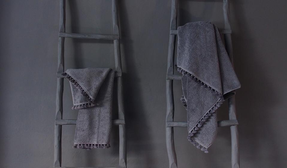 grey bath towel lamu with handmade pompons