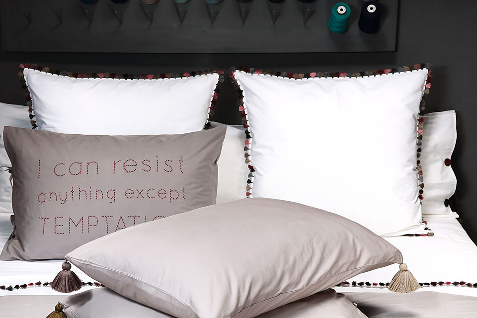 slow bed linen with pompoms by valerie barkowski luxury home textiles with hand embroidery