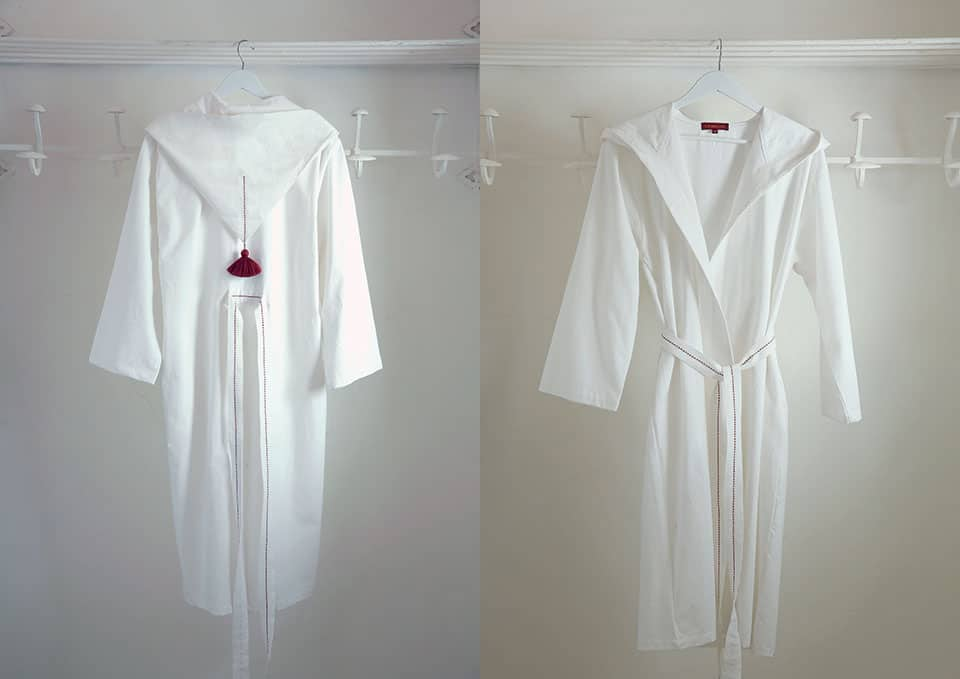White cotton bathrobe with hand embroidery. High end home linens