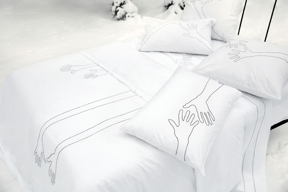 High end hand embroidery on luxury bed sheet and pillow case.
