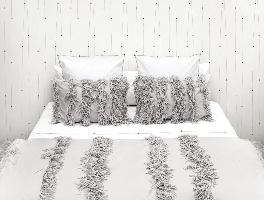 Luxury white bed linen with handmade trimmings design Valerie Barkowski